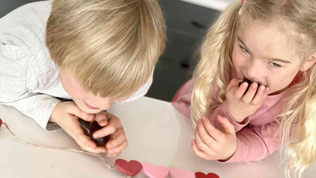 2 kids enjoying heart-shaped brownies